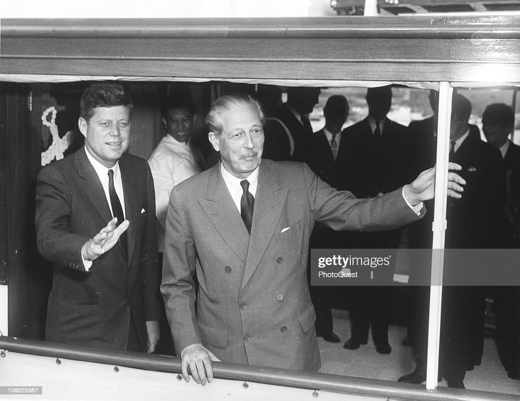 US President <a gi-track='captionPersonalityLinkClicked' href=/galleries/search?phrase=John+F.+Kennedy+-+US+President&family=editorial&specificpeople=70027 ng-click='$event.stopPropagation()'>John F. Kennedy</a> (1917 - 1963) (left) and British Prime Minister Harold MacMillan (1894 - 1986) ride the on board the presidential yacht 'Honey Fitz,' April 6, 1961.