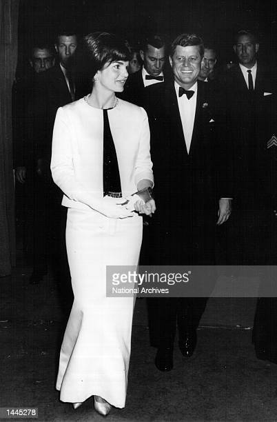 President John F Kennedy and First Lady Jackie Kennedy attend a ceremony November 29 1962 in Washington DC