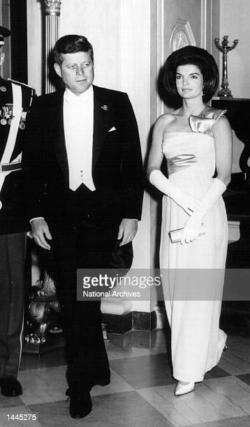 President John F Kennedy and First Lady Jackie Kennedy attend a White House Ceremony January 21 1963 in Washington DC