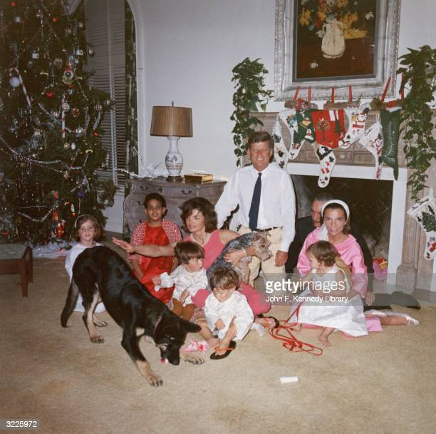 US President John F Kennedy and First Lady Jacqueline Kennedy pose with their family on Christmas Day at the White House Washington DC December 25...