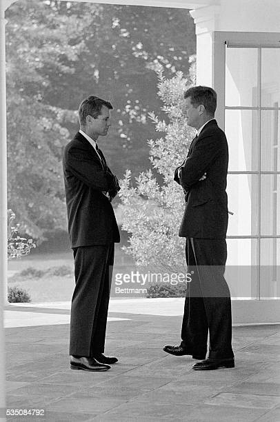 President John F Kennedy and his brother Attorney General Robert F Kennedy speak together after participating in a ceremony at the White House in...