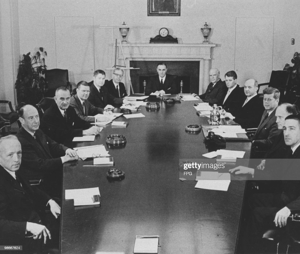 U.S. President John F. Kennedy (1917 - 1963) and his cabinet at the White House, Washington DC, 1961. Clockwise, from left: Postmaster General J. Edward Day, Ambassador to the U.N. Adlai Stevenson, Vice President Lyndon B. Johnson, Defense Secretary Robert S. McNamara, Agriculture Secretary Orville L. Freeman, Labor Secretary Arthur J. Goldberg, Health and Human Services Secretary Abraham A. Ribicoff, Commerce Secretary Luther H. Hodges, Attorney General Robert F. Kennedy, Secretary of State Dean Rusk, John F. Kennedy, Treasury Secretary C. Douglas Dillon and Interior Secretary Stewart L. Udall.