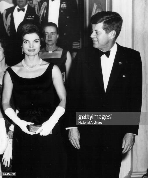 President John F Kennedy and Jackie Kennedy attend a White House Ceremony February 19 1963 in Washington DC