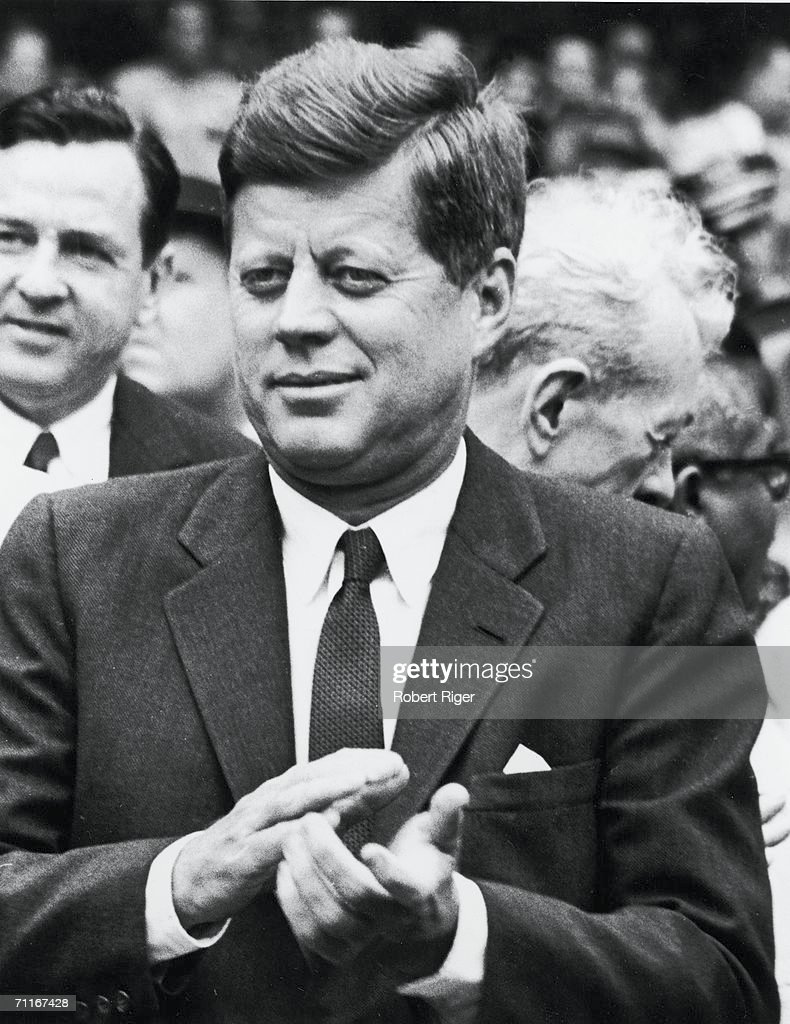 US President <a gi-track='captionPersonalityLinkClicked' href=/galleries/search?phrase=John+F.+Kennedy+-+US+President&family=editorial&specificpeople=70027 ng-click='$event.stopPropagation()'>John F. Kennedy</a> (1917 - 1963) applauds during a Washington Senators baseball game, Washington DC, early 1960s.