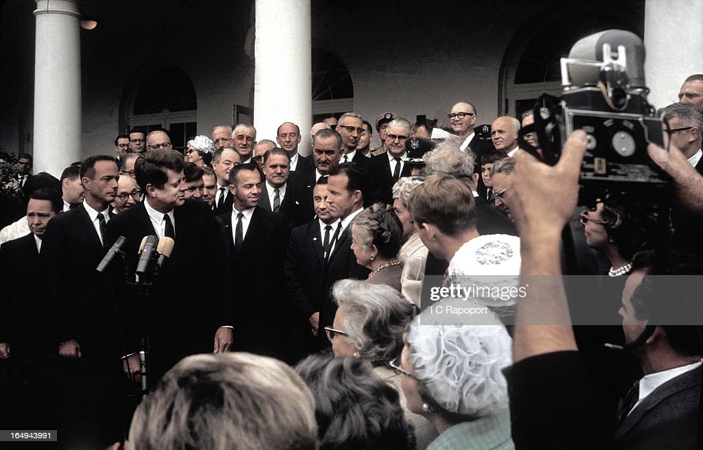 President <a gi-track='captionPersonalityLinkClicked' href=/galleries/search?phrase=John+F.+Kennedy+-+US+President&family=editorial&specificpeople=70027 ng-click='$event.stopPropagation()'>John F. Kennedy</a> awards the Collier Trophy to the seven Mercury astronauts in the White House rose garden. (Identifiable persons are, l to r: Lt. Comdr <a gi-track='captionPersonalityLinkClicked' href=/galleries/search?phrase=Scott+Carpenter+-+Astronaut&family=editorial&specificpeople=92555 ng-click='$event.stopPropagation()'>Scott Carpenter</a> at JFK's right shoulder, Lt. Comdr <a gi-track='captionPersonalityLinkClicked' href=/galleries/search?phrase=Wally+Schirra&family=editorial&specificpeople=263043 ng-click='$event.stopPropagation()'>Wally Schirra</a> half-hidden over JFK's left shoulder, Comdr. Alan Shepard, Capt. Gus Grissom and Capt. <a gi-track='captionPersonalityLinkClicked' href=/galleries/search?phrase=Gordon+Cooper+-+Astronaut&family=editorial&specificpeople=90970 ng-click='$event.stopPropagation()'>Gordon Cooper</a> (making eye contact with the President). In the background, center, Vice President <a gi-track='captionPersonalityLinkClicked' href=/galleries/search?phrase=Lyndon+Johnson&family=editorial&specificpeople=91450 ng-click='$event.stopPropagation()'>Lyndon Johnson</a>, behind him, Secretary of State Adlai Stevenson and half-hidden, Sen. <a gi-track='captionPersonalityLinkClicked' href=/galleries/search?phrase=Hubert+Humphrey&family=editorial&specificpeople=91105 ng-click='$event.stopPropagation()'>Hubert Humphrey</a>) on October 10, 1963 in Washington, DC.