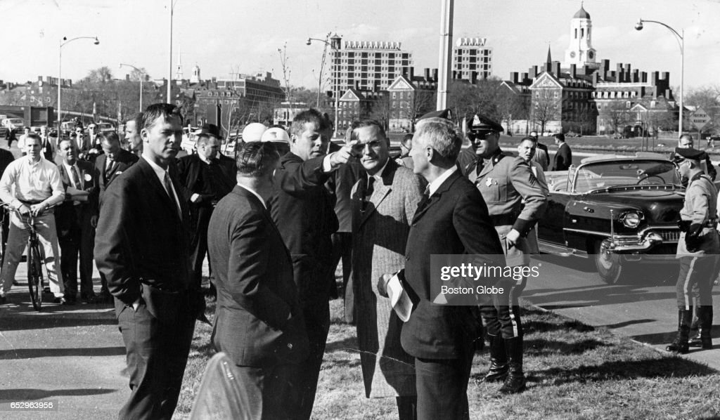 President John F. Kennedy, gesturing at center, stands with, from left, Massachusetts Gov. Endicott Peabody, national archivist Wayne Grover, Boston lawyer Edward B Hanify, and L.G. Wiggins, administrative vice president of Harvard in Boston on Apr. 18, 1963. The President, en route from Boston College to Logan Airport, is seeking a site for his presidential library.
