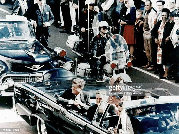 President John F Kennedy in the presidential limousine before his assassination His wife Jacqueline is next to him and Texas Governor John Connally...