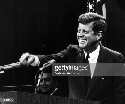 President John F Kennedy laughs during a press conference August 9 1963