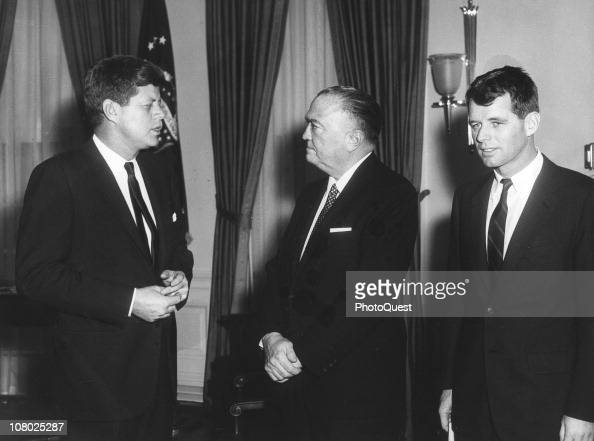 US President John F Kennedy meets with FBI Director J Edgar Hoover while his brother Attorney General Robert F Kennedy stands with them in the White...