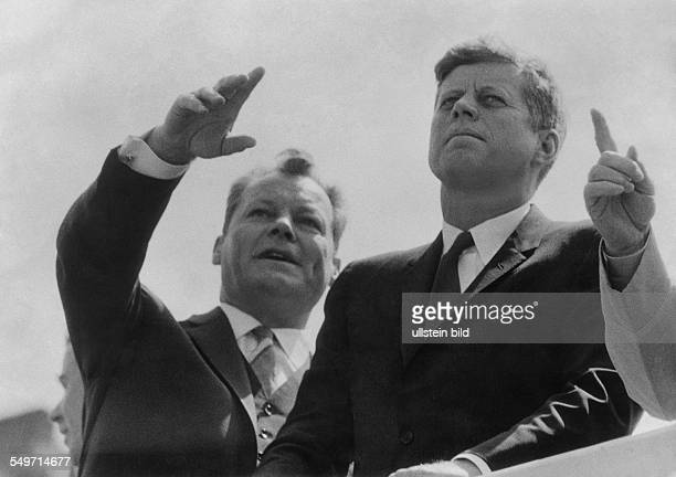 US President John F Kennedy on a visit to West Berlin with Wiilly Brandt Mayor of West Berlin during a visit to the Berlin Wall