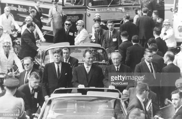 President John F Kennedy rides alongside Berlin Mayor Willie Brandt and German chancellor Konrad Adenauer during Kennedy's visit to Berlin Germany...