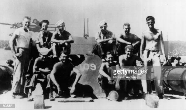 President John F Kennedy served as a US Navy lieutenant and commander of a patrol torpedo boat during World War II Kennedy is shown at the extreme...