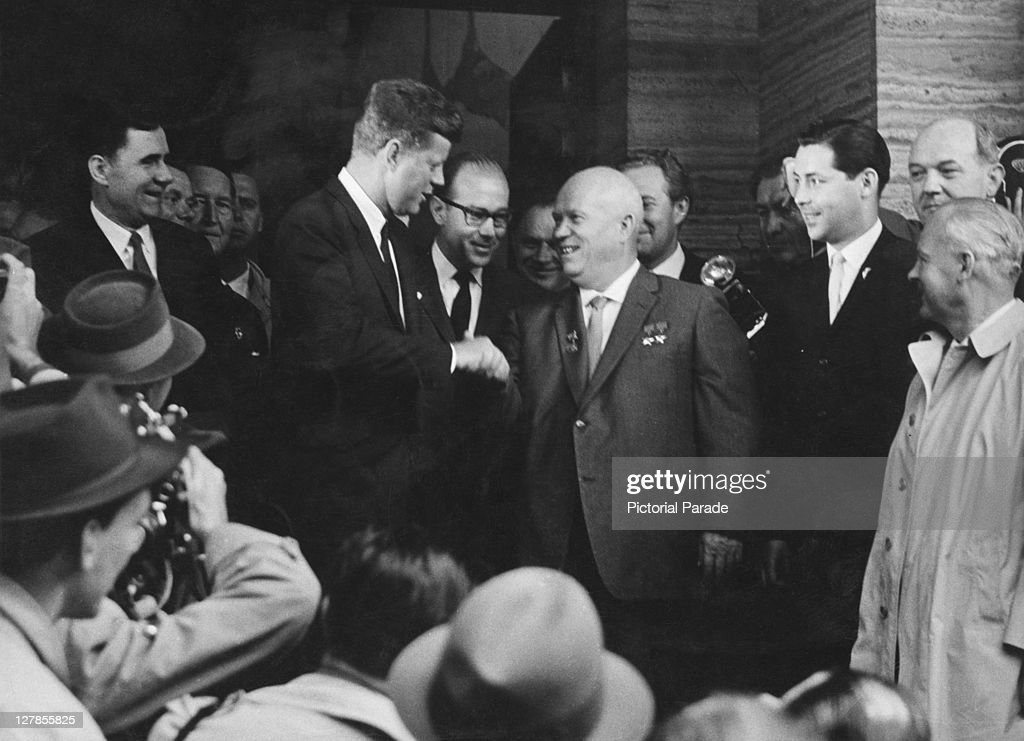 US President John F Kennedy (1917 - 1963, left) shakes hands with Soviet premier <a gi-track='captionPersonalityLinkClicked' href=/galleries/search?phrase=Nikita+Khrushchev&family=editorial&specificpeople=92216 ng-click='$event.stopPropagation()'>Nikita Khrushchev</a> (1894 - 1971) at the Vienna Summit, Austria, 4th June 1961. (Photo by Pictorial Parade/Archive Photos/Getty Images) US