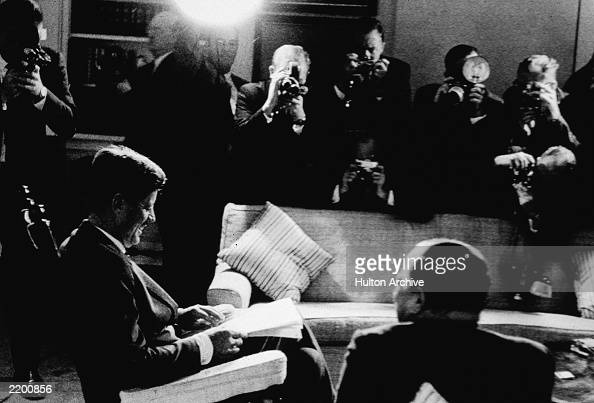 US president John F Kennedy signs the Blockade Proclamation before photographers during the Cuban Missile Crisis Washington DC November 3 1962