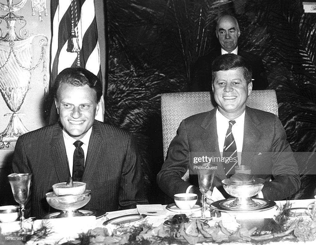 US President John F Kennedy sits with Christian evangelist Billy Graham at the National Prayer Breakfast Washington DC February 9 1994