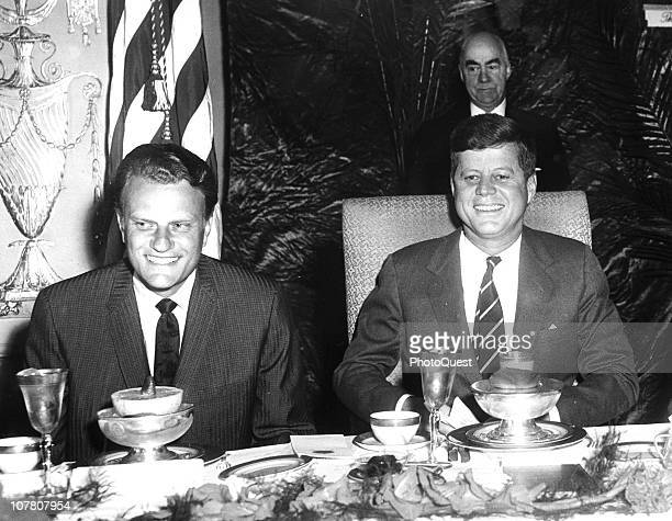 US President John F Kennedy sits with Christian evangelist Billy Graham at the National Prayer Breakfast Washington DC February 9 1994