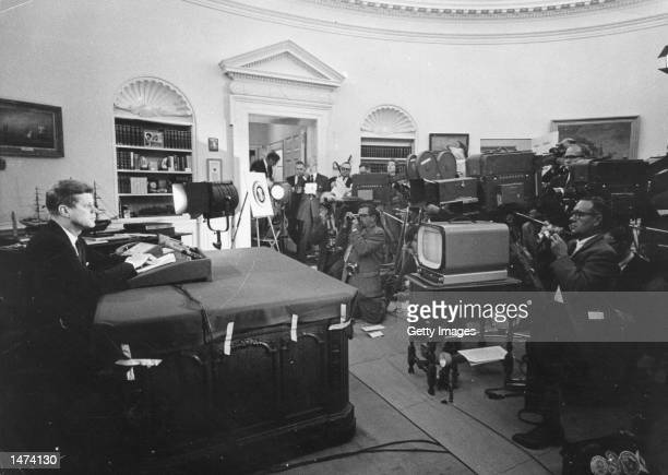 US President John F Kennedy speaks during a televised speech to the nation about the strategic blockade of Cuba and his warning to the Soviet Union...