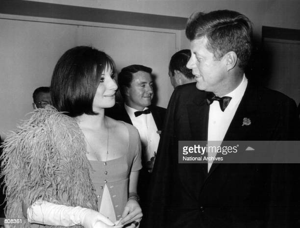 President John F Kennedy speaks with Barbra Streisand at an event May 24 1963
