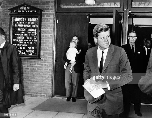 US President John Fitzgerald Kennedy leaves the Saint Stephen Martyr catholic church after attending mass on October 28 1962 in Washington DC few...