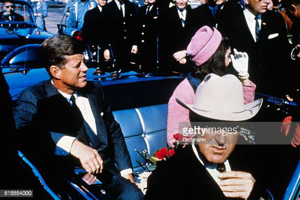 President John Kennedy rides in a motorcade from the Dallas airport into the city with his wife Jacqueline and Texas Governor Johhn Connally