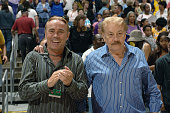 President Johnny Buss and Chairman Dr Jerry Buss of the Los Angeles Sparks pose for the camera in the stands during a game against the Minnesota Lynx...