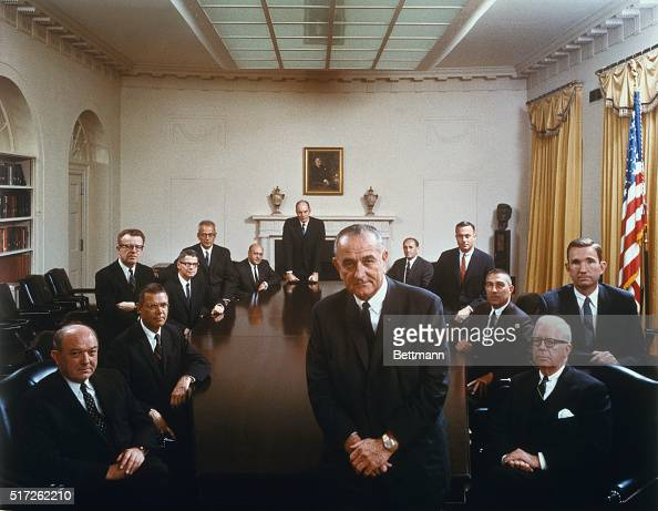 President Johnson poses with his cabinet in this color photo taken by the White House last Wednesday and released April 7 Clockwise around the...