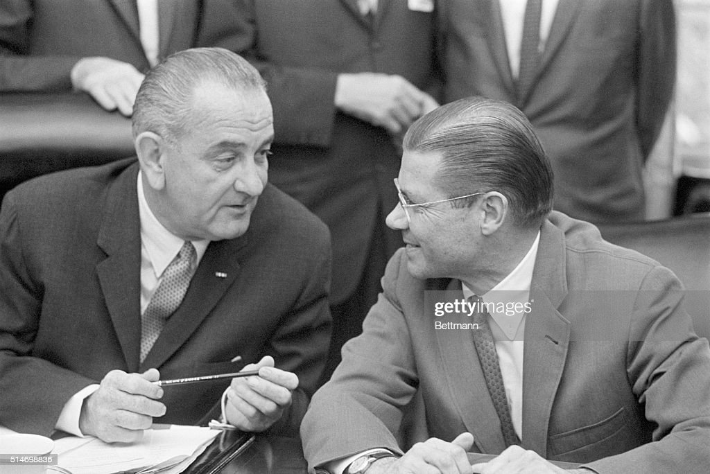 President Johnson speaks with Secretary of Defense Robert McNamara on October 19 1964 They are at a briefing for Congressional leaders about the...