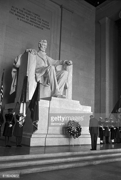 President Johnson stands with head bowed after placing a wreath at the statue of Abraham Lincoln in the Lincoln Memorial today at ceremonies marking...