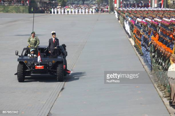 President JOKO WIDODO inspect the troops during the 72nd Indonesia National Army Day at Indah Kiat harbour Cilegon Banten province on Thursday...