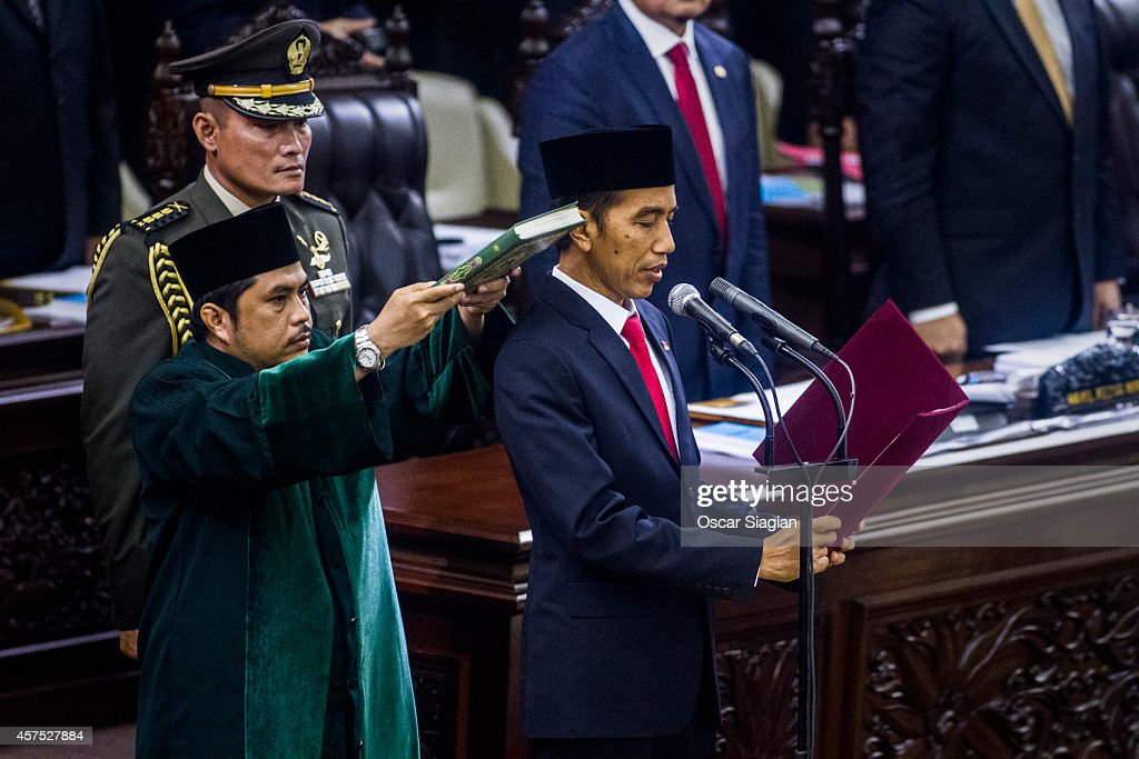 President <a gi-track='captionPersonalityLinkClicked' href=/galleries/search?phrase=Joko+Widodo&family=editorial&specificpeople=6657368 ng-click='$event.stopPropagation()'>Joko Widodo</a> is sworn in during his inauguration ceremony at the House of Representative building on October 20, 2014 in Jakarta, Indonesia. Widodo was the eventual winner of a tightly fought and sometimes controversial election race against opposition candidate Prabowo Subianto. A number of key world leaders will be in attendance including Australia's prime minister Tony Abbott.