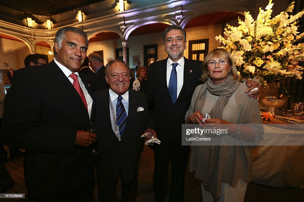 President Jose Quiñones (3L-R)and Peruvian shooter and Olympic medalist Francisco Boza (L) during the gala dinner on the second day of the 15th IOC World Conference Sports For All at Casa García Alvarado on April 25, 2013 in Lima, Peru.