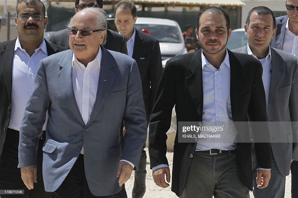 President, Joseph Blatter (L) and FIFA Vice-President Prince Ali bin al-Hussein from Jordan arrive to visit the northern Jordanian Zaatari refugee camp on July 6, 2013 in Mafraq near the border with Syria. Blatter is on a four-day-official visit to Jordan, Palestinian territories and Israel during which he will notably launch football turf fields. AFP/PHOTO/KHALIL MAZRAAWI