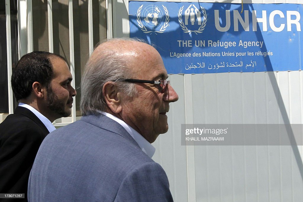 President, Joseph Blatter (R) and FIFA Vice-President Prince Ali bin al-Hussein from Jordan arrive to visit the northern Jordanian Zaatari refugee camp on July 6, 2013 in Mafraq near the border with Syria. Blatter is on a four-day-official visit to Jordan, Palestinian territories and Israel during which he will notably launch football turf fields. AFP/PHOTO/KHALIL MAZRAAWI