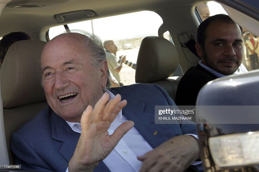 President, Joseph Blatter (L) and FIFA Vice-President Prince Ali bin al-Hussein from Jordan arrive for a visit at the northern Jordanian Zaatari refugee camp on July 6, 2013 in Mafraq near the border with Syria. Blatter is on a four-day-official visit to Jordan, Palestinian territories and Israel during which he will notably launch football turf fields. AFP/PHOTO/KHALIL MAZRAAWI