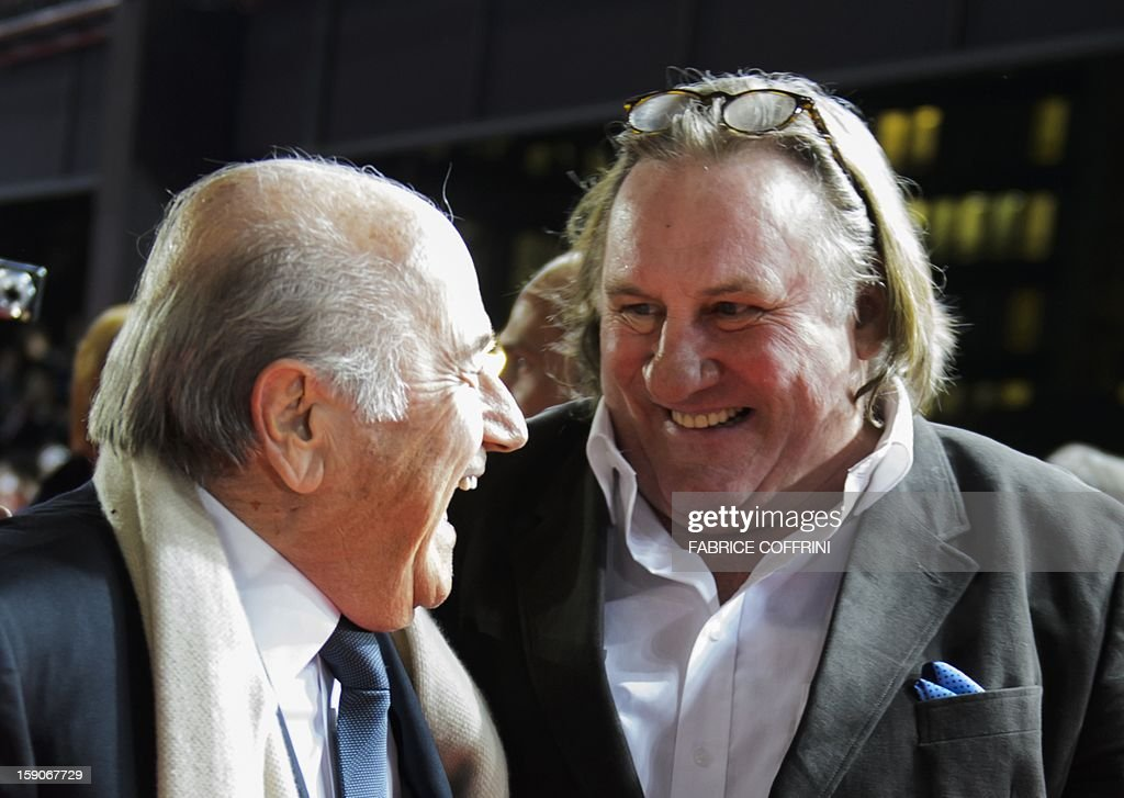 President Joseph Blatter (L) and French actor Gerard Depardieu share a joke on arrival at the FIFA Ballon d'Or awards ceremony at the Kongresshaus in Zurich on January 7, 2013.