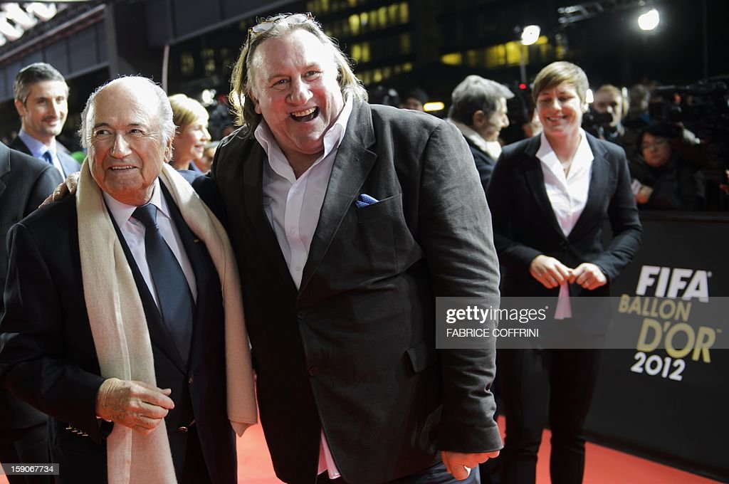 President Joseph Blatter (L) and French actor Gerard Depardieu share a joke on arrival at the FIFA Ballon d'Or awards ceremony at the Kongresshaus in Zurich on January 7, 2013. AFP PHOTO / FABRICE COFFRINI