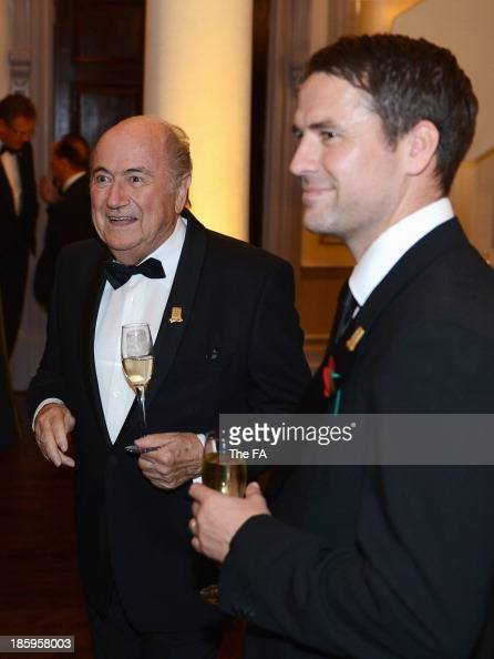 President Joseph Blatter looks on with Michael Owen during the FA150 Gala Dinner commemorating the Football Association's 150th year at the Grand...