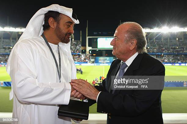 FIFA president Joseph Blatter speaks to crown prince of the United Arab Emirates Sheikh Mohammad bin Zayed Al Nahyan while presenting him with a...