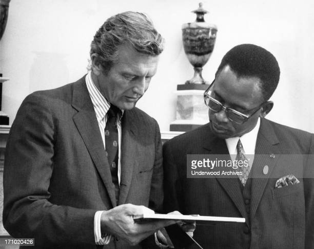 President Joseph Mobutu of the Democratic Republic of the Congo and NY Mayor John Lindsey looking at a picture New York New York August 11 1970