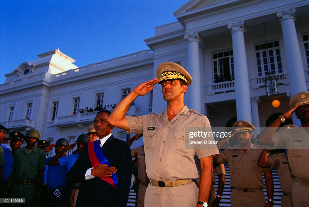 President Joseph Negrette stands near General Raoul Cedras who formerly led a coup against President JeanBertrand Aristide