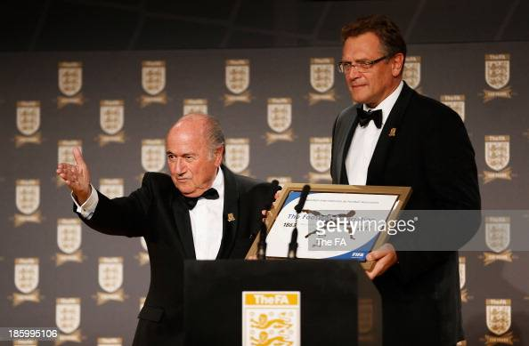 President Joseph S Blatter and FIFA Secretary General Jerome Valcke make a presentation to FA Chairman Greg Dyke during the FA150 Gala Dinner...