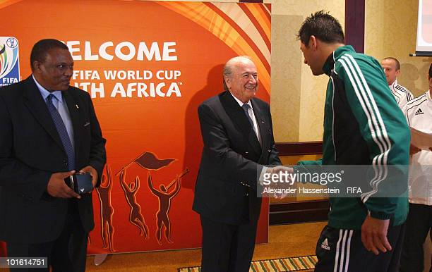 FIFA president Joseph S Blatter and organising chairman Irvin Khoza handover a commemorative pennant to referee Thorsten Kinhoefer of Germany during...