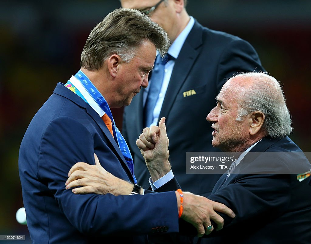 President Joseph S. Blatter congratulates head coach Louis van Gaal of the Netherlands during the medal ceremony after the 2014 FIFA World Cup Brazil 3rd Place Playoff match between Brazil and Netherlands at Estadio Nacional on July 12, 2014 in Brasilia, Brazil.