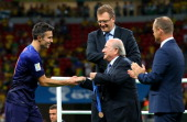 President Joseph S Blatter congratulates Robin van Persie of the Netherlands during the medal ceremony after the 2014 FIFA World Cup Brazil 3rd Place...