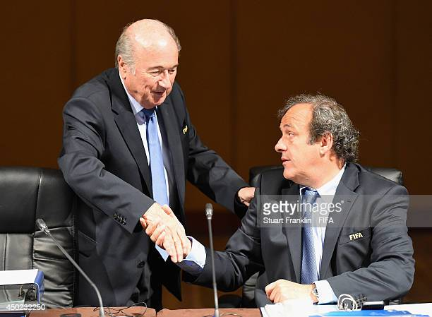 President Joseph S Blatter greets Michel Platini UEFA President and member of the FIFA Executive Committee during the FIFA EXCO meeting at the Grand...