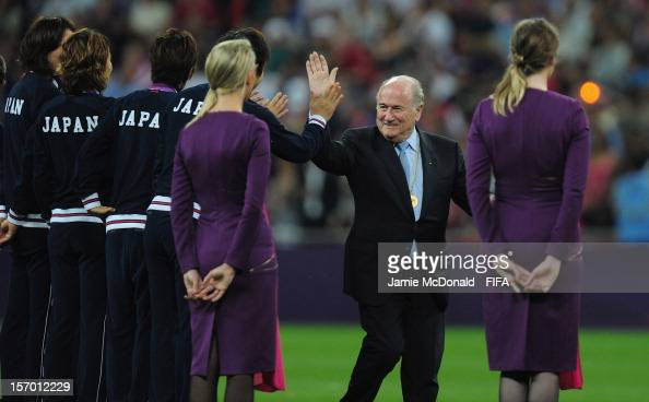 President Joseph S Blatter hands out medals during the Women's Football Gold Medal match between USA and Japan on Day 13 of the London 2012 Olympic...