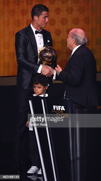 President Joseph S Blatter hands over the award to Crisitano Ronaldo of Portugal during FIFA Ballon d'Or 2013 trophy at the Kongresshalle on January...