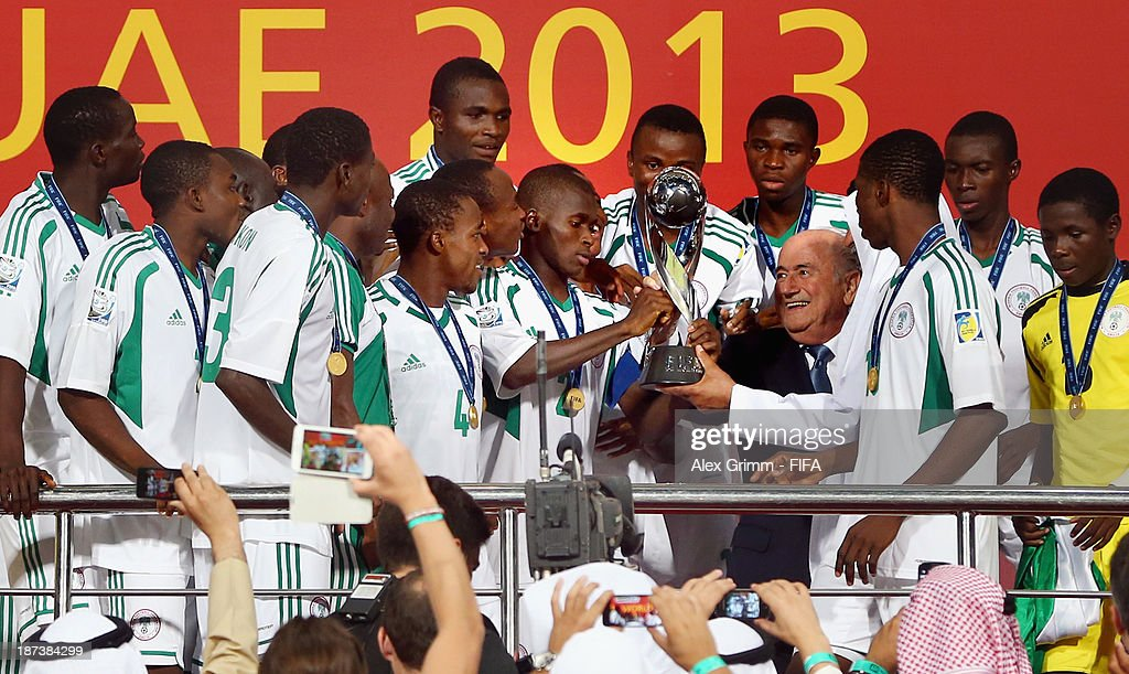 President Joseph S. Blatter hands over the trophy to team captain Musa Muhammed of Nigeria after the FIFA U-17 World Cup UAE 2013 Final between Nigeria and Mexico at Mohamed Bin Zayed Stadium on November 8, 2013 in Abu Dhabi, United Arab Emirates.