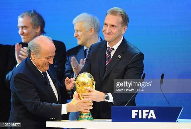 President Joseph S Blatter hands the World Cup trophy to Deputy Prime Minister Igor Shuvalov of Russia after Russia won the bid to host the 2018...