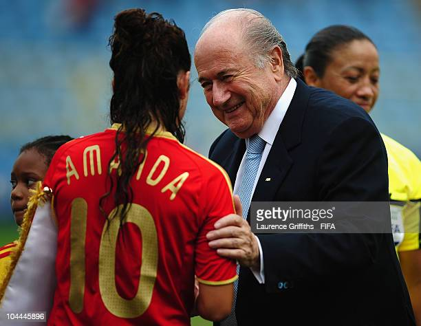 President Joseph S Blatter is introduced to the Spain team by captain Amanda Sampedro during the FIFA U17 Women's World Cup 3rd Place Playoff match...